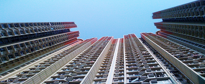 Picture of split-system air conditioning units on the façade of a residential high-rise in Kowloon, Hong Kong.
