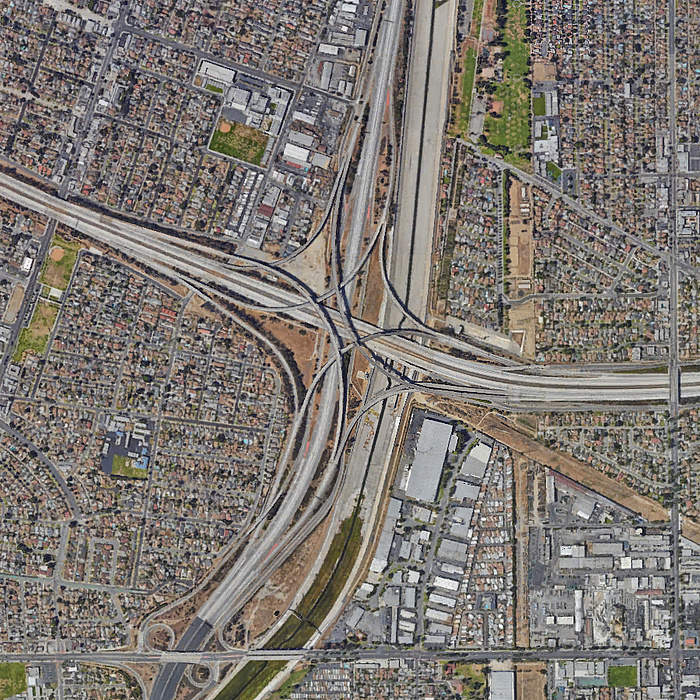 Aerial view of the large-scale point of intersection of the Interstate 710 and Interstate 105 city freeways in the centre of Los Angeles, California.