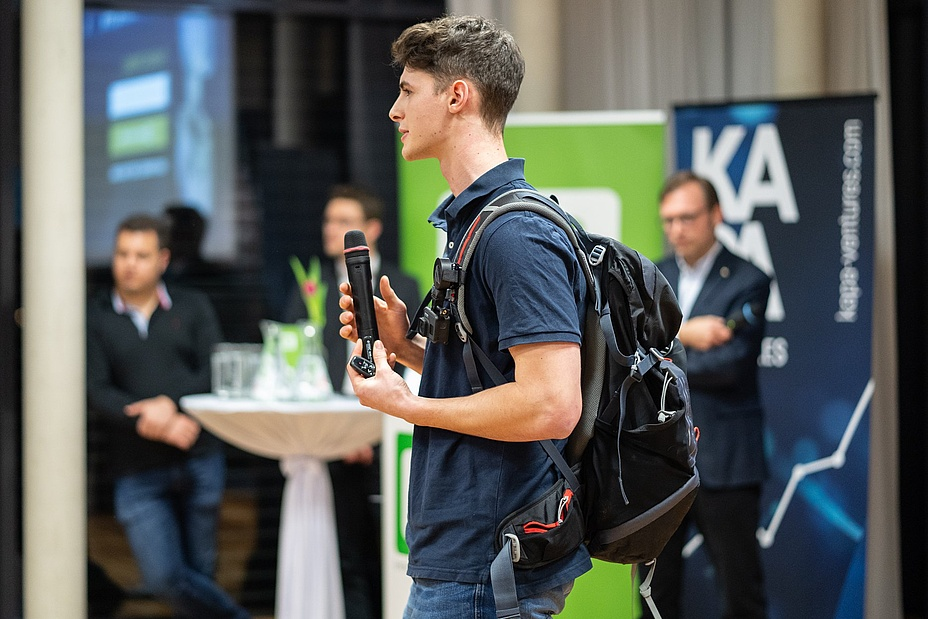 TU Graz student with backpack at a presentation