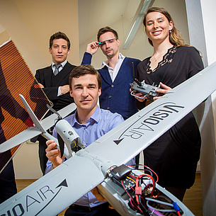Several people with a model airplane. Photo source: Lunghammer - TU Graz
