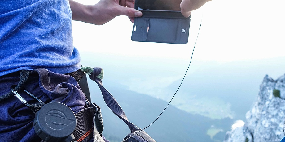 mobile phone attached to waist with rope pull