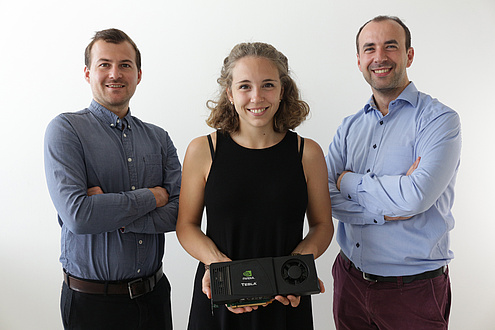 Three persons with graphics processor