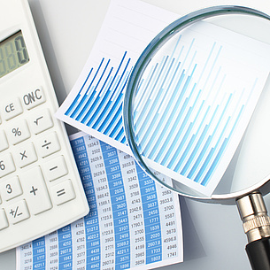 A calculator, a magnifying glass and lists. Photo source: tadamichi - Fotolia.com