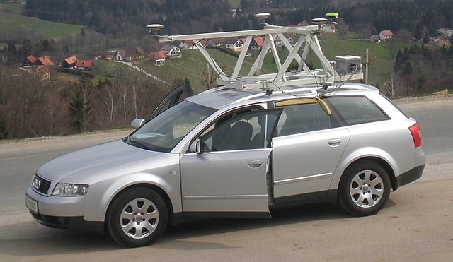 This picture shows a car carrying the platform of the institute with 4 GNSS antennas and receivers and different kinds of inertial measurement units