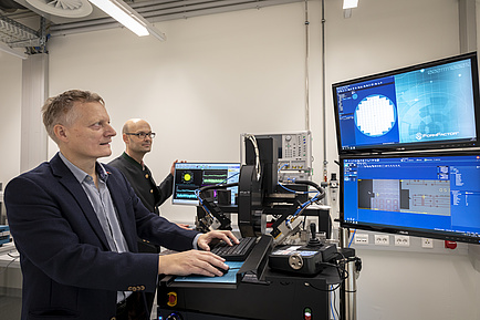 Researchers in front of Computers and Monitors