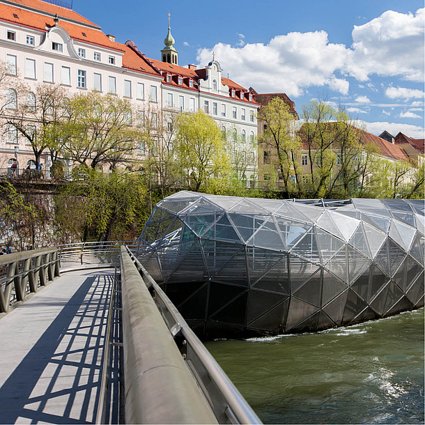 Bridge and the steel island in the river Mur. Photo source: Graz Tourismus - Harry Schiffer