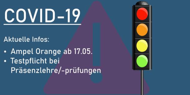 Traffic lights, besides a text in German: COVID-19. Aktuelle Infos: Ampel Orange ab 17.05. Testpflicht bei Präsenzlehre/-prüfungen.