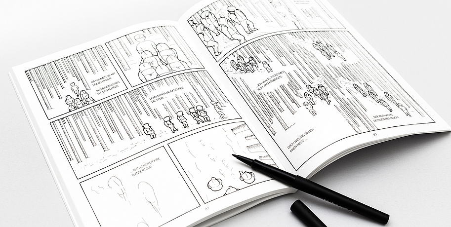 "The comic ""In Mind"" is presented on a white table. The drawings are black and white und are showing people wearing hoodies walking through a forest. There is a black pen next to the comicbook."