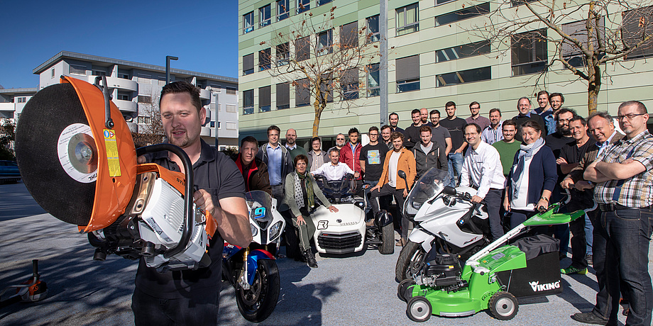 A group of people, on the left a man with a hand-held concrete grinder, in the middle personal mobility vehicles and on the right a lawn mower.