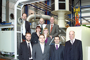 Participants of the pretest meeting of the EU project DREAM in front of the turbine test facility at the institute.