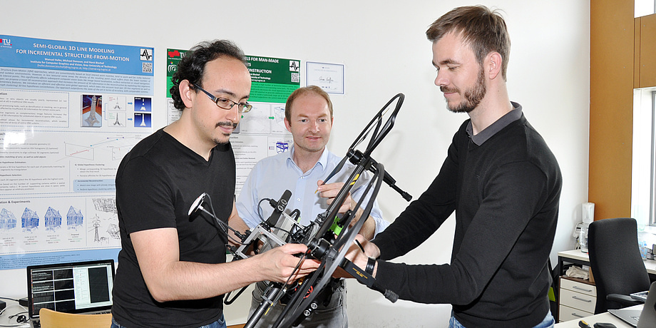 Jesus Pestana Puerta, Friedrich Fraundorfer and Michael Maurer are preparing the drone for the flight.