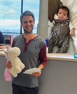 Research Assistant Philipp Bruckner receives a present for his newborn daughter Emilia from the colleagues of the institute. Congratulations and all the best!