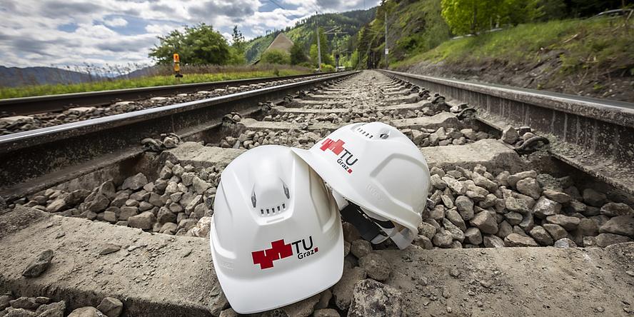 A helmet inbetweet to rail tracks.