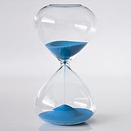 Sandglass filled with blue sand. Photo source: xaviersarrent – fotolia.com