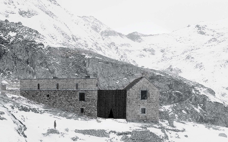 Buildings made of wood and stone in a snowy high mountain landscape