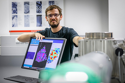 Researchers behind a computer screen