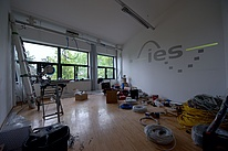 Room with tools and cables lying around and the IES logo on the wall.