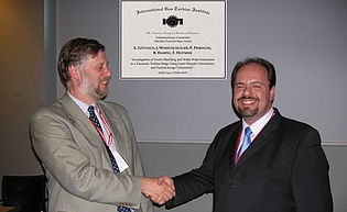 """Presentation of the """"Best Paper Award"""" to Dr. Emil Goettlich by Prof. Howard Hodson of Cambridge University, chair of the Turbomachinery Committee, during the ASME IGTI conference 2006 in Barcelona"""