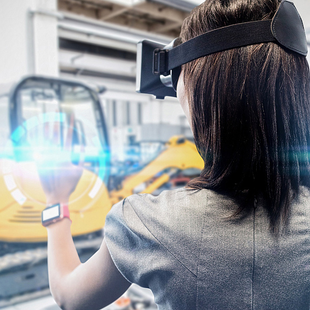 A young woman is wearing virtual reality glasses.