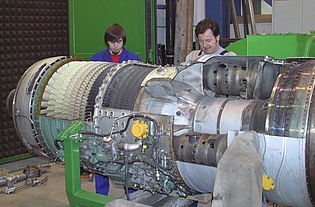 Mr. Turcsanyi and Mr. Preßnitz working on the cut-model of a Svenska Flygmotor RM6C