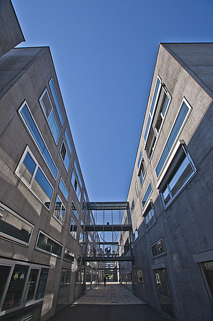 Perspective view of modern grey buildings.