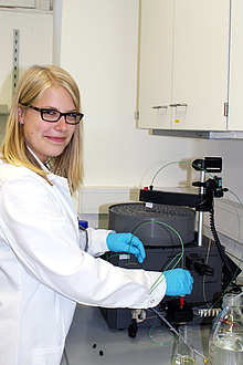 Researcher in front of laboratory device
