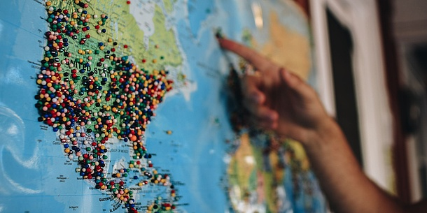 World map with pins. Source: Kelsey Knight – Unsplash.com