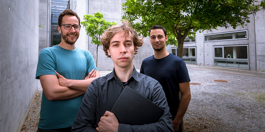 Three researchers with laptop
