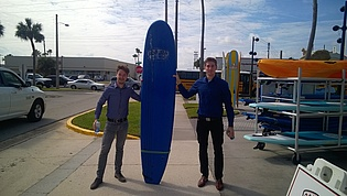 M. Schriefl and B. Lang with a surfboard.