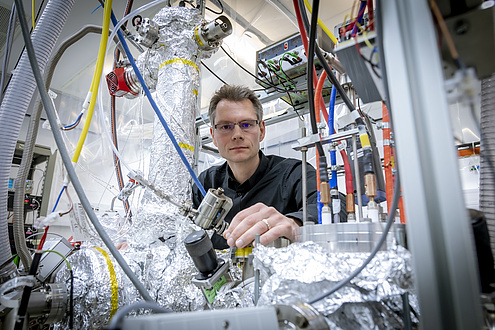 Researchers before femtosecond lasers