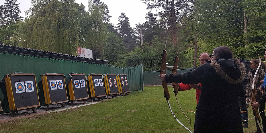 Group of people on an archery range