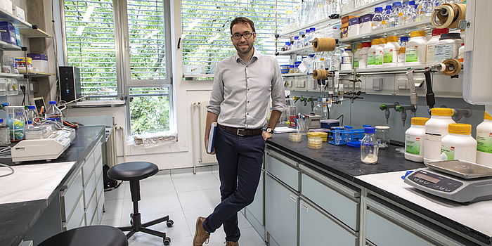 A man standing at a lab.