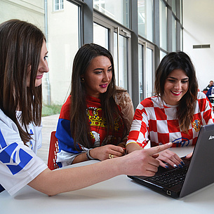 Three women with a laptop. Photo source: Aldin Hajdukovic