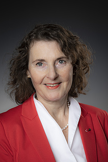 Portrait of Andrea Hoffmann in white blouse and red blazer