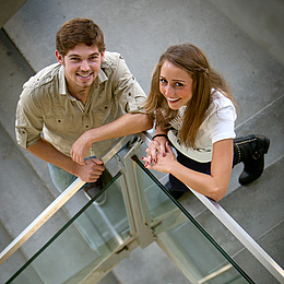 Man and woman standing on the stairs and looking into the camera. Photo source: Lunghammer - TU Graz