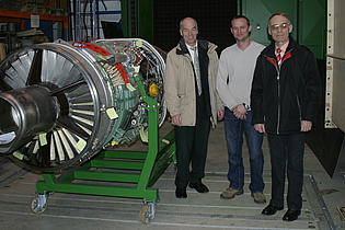 Prof. Heitmeir, Mr. Haubenhofer and Mr. Antonitsch (from the left) next to the cut-off model of the Saab Draken jetengine at the institute.
