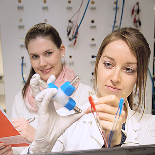 Two young women in a lab.