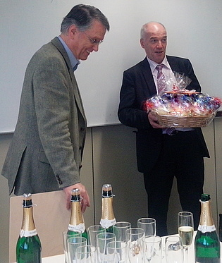 Prof. Heitmeir presents Prof. Pirker the institute's birthday present!