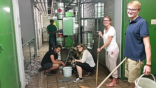 All-purpose education: Our PhD students fight the flooding of our institute after heavy rainfall