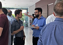 Participants of the seminar talking.
