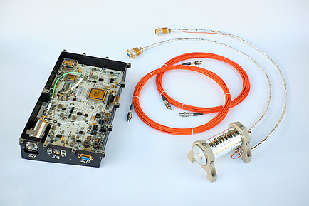 component with visible electronic components, two rings and cables