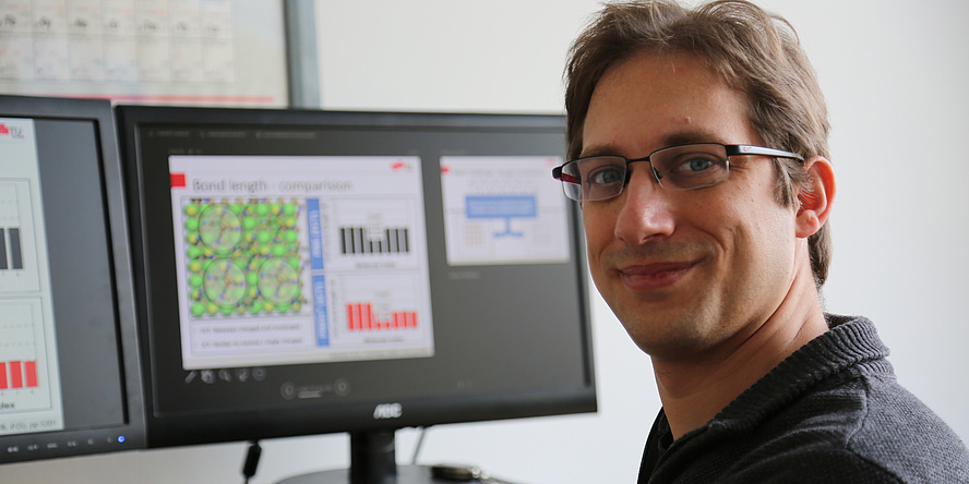 Researcher in front of screen