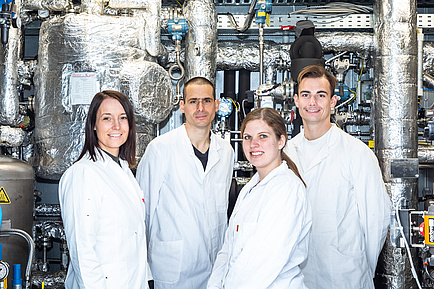 Four researchers in white coats
