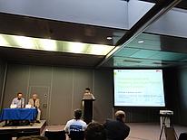 Mario Schriefl on the podest giving a talk.