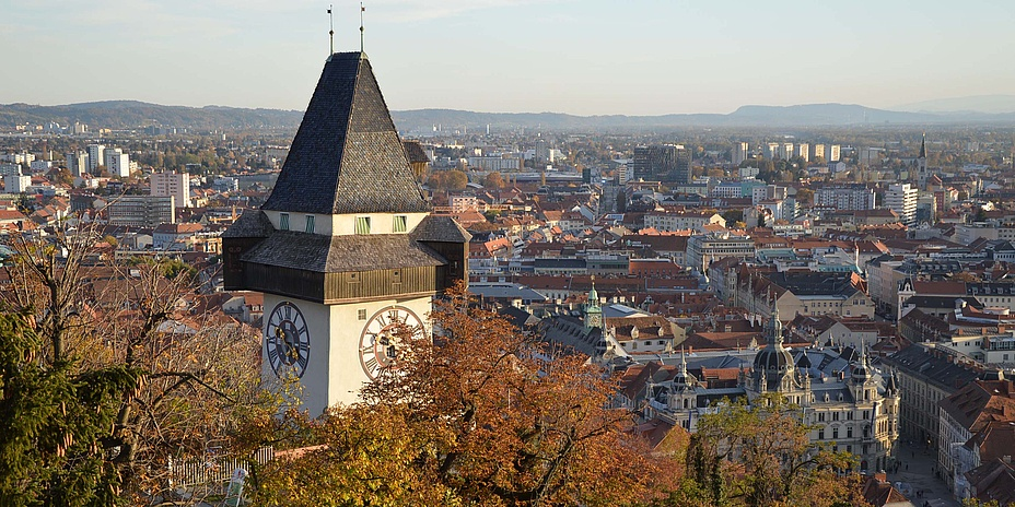 Medieval clock tower with a view over the city of Graz