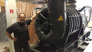 Emil Göttlich in front of the air supply compressor for our new wind tunnel provided by General Electric