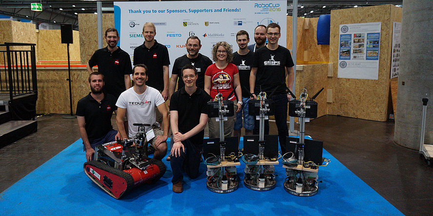 Two successful TU Graz robotic teams; also showing at the picture rescue robot Wowbagger of Team TEDUSAR and three logistics robots of Team GRIPS