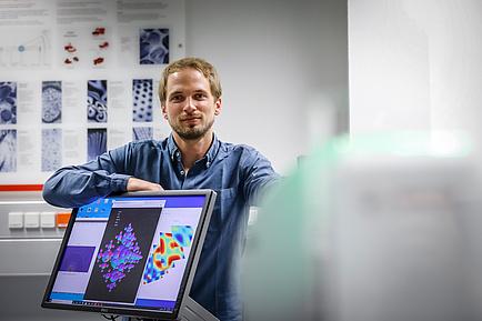 Researcher behind a computer screen