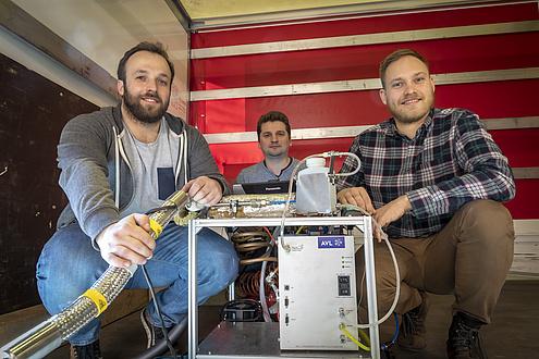 3 Forscher mit Messystem