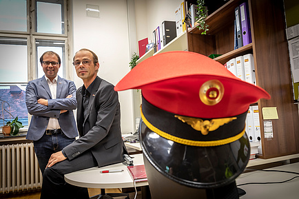 Two TU Graz researchers, in the foreground a conductor's cap